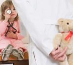 Doctor with teddy bear for patient