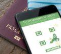 Digital,Green,Pass,Concept:,Smartphone,Over,A,Passport,And,A